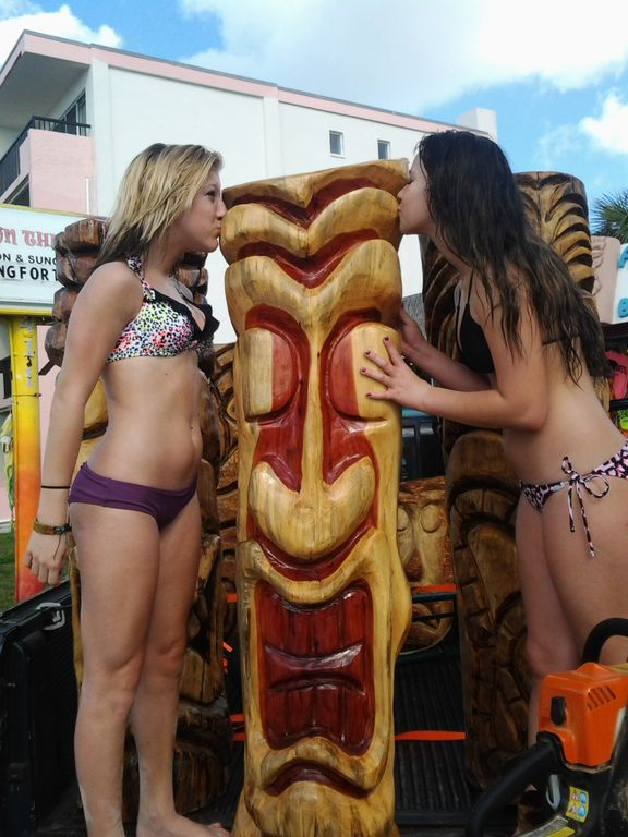 women  next to tikis